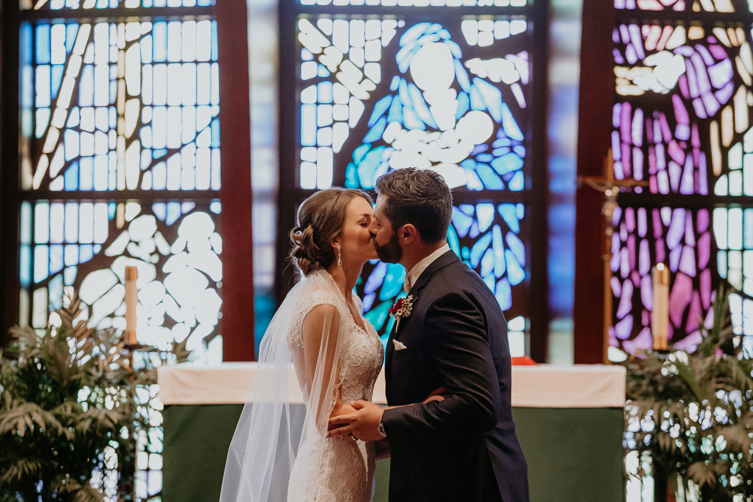newlyweds first kiss inside nativity Catholic Church