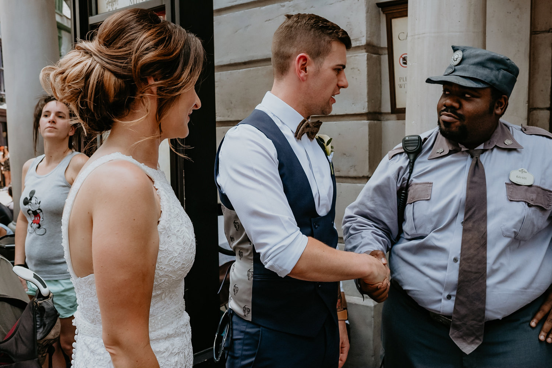 groom shaking hands with universal studios employee at gringotts bank