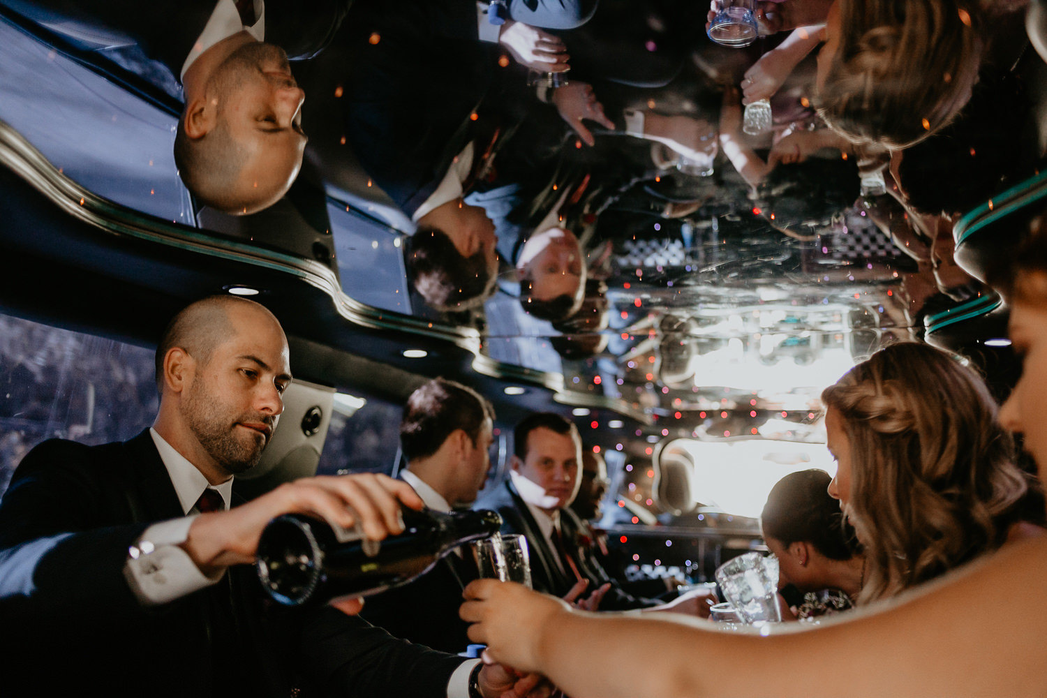 pouring champagne inside the limousine