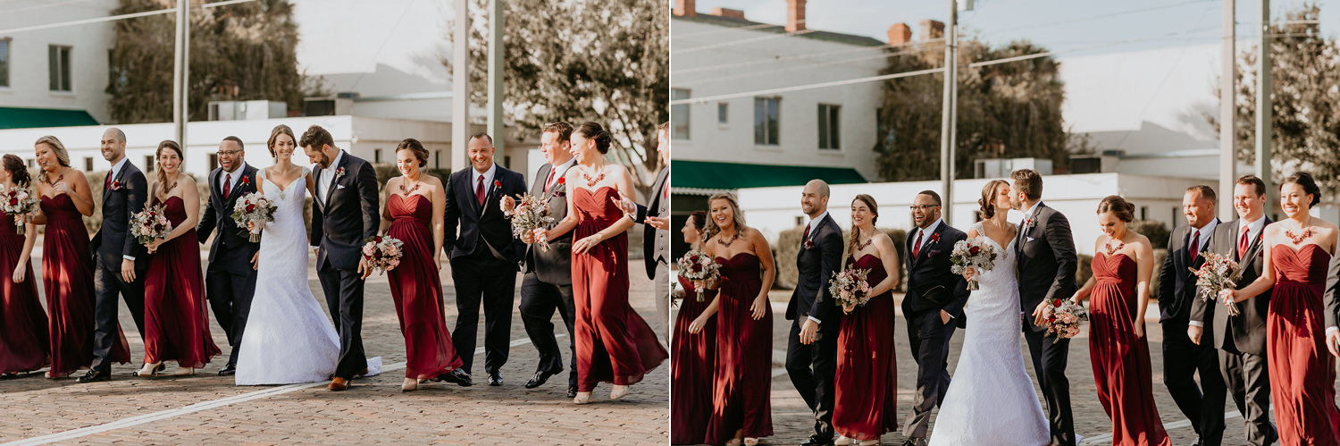 bridal party walking on cobblestone street in downtown Sanford