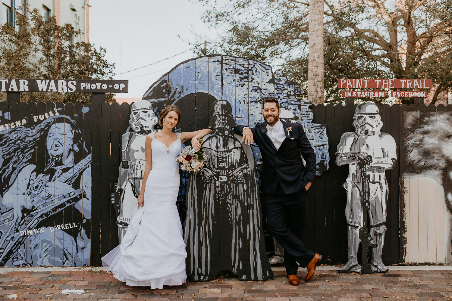 bride and groom posing with a cardboard Darth Vader in downtown Sanford