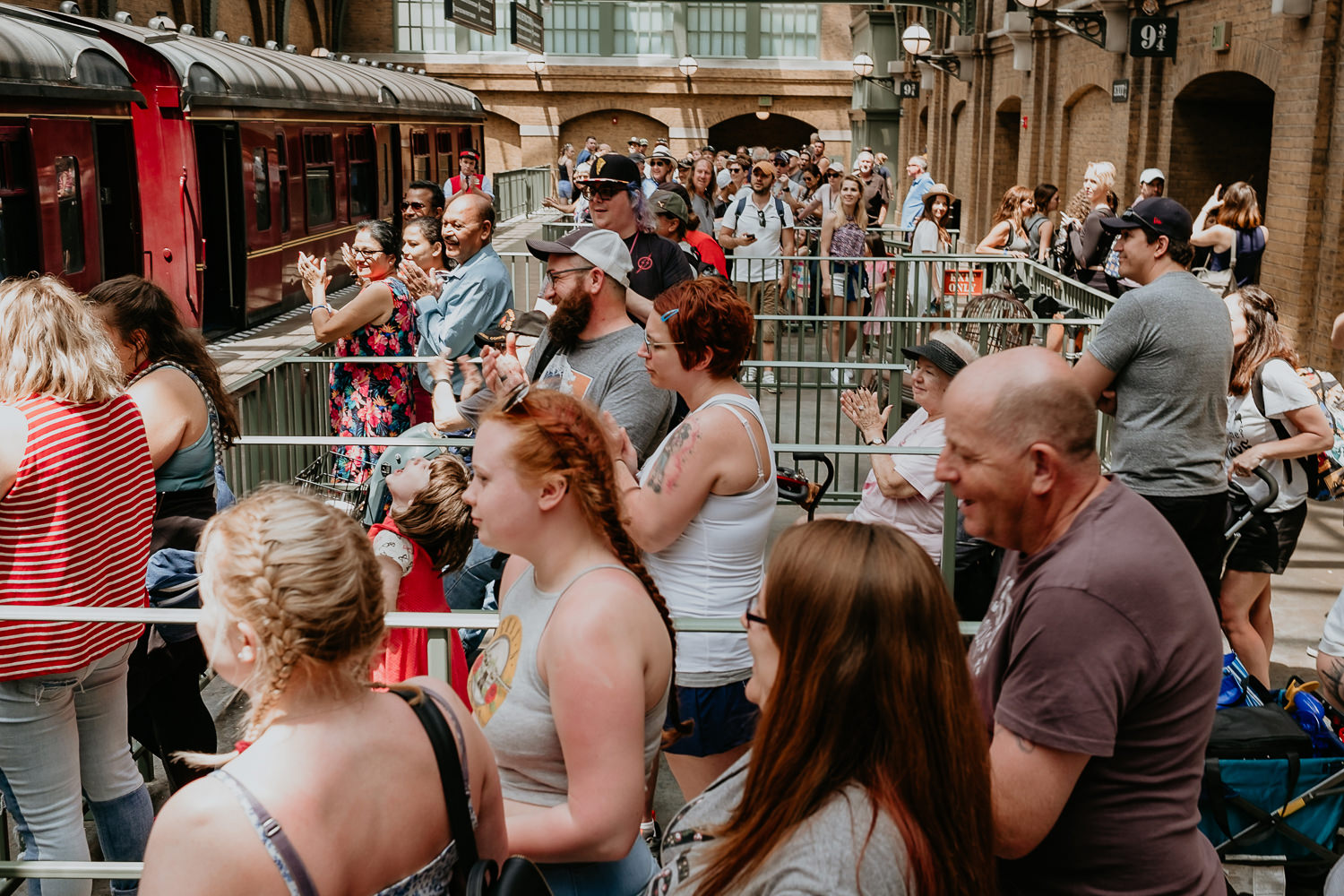 view of crowd at Hogwarts Express link all cheering and applauding