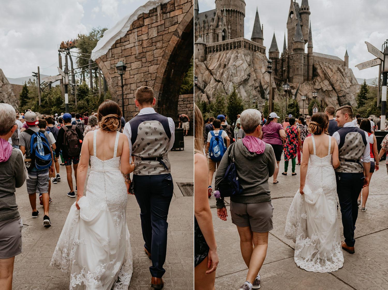 newlyweds walking towards Hogwarts castle