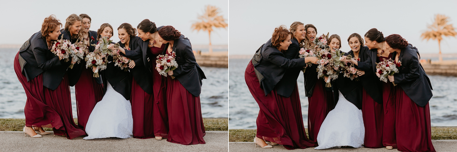 bridesmaids and bride wearing groomsmen blazers laughing at each other