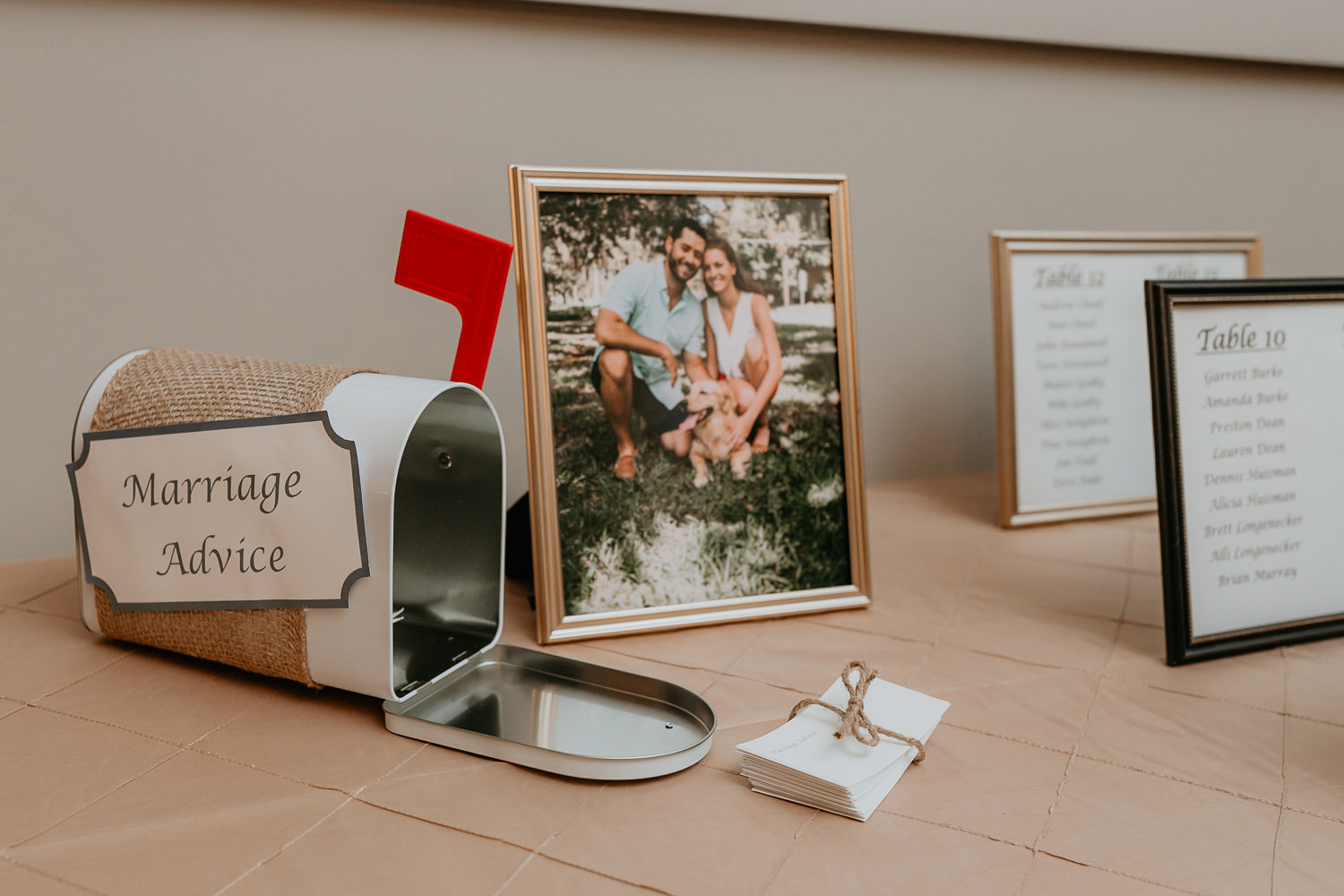 mailbox wrapped in ropes with sigh for guest to leave marriage advice