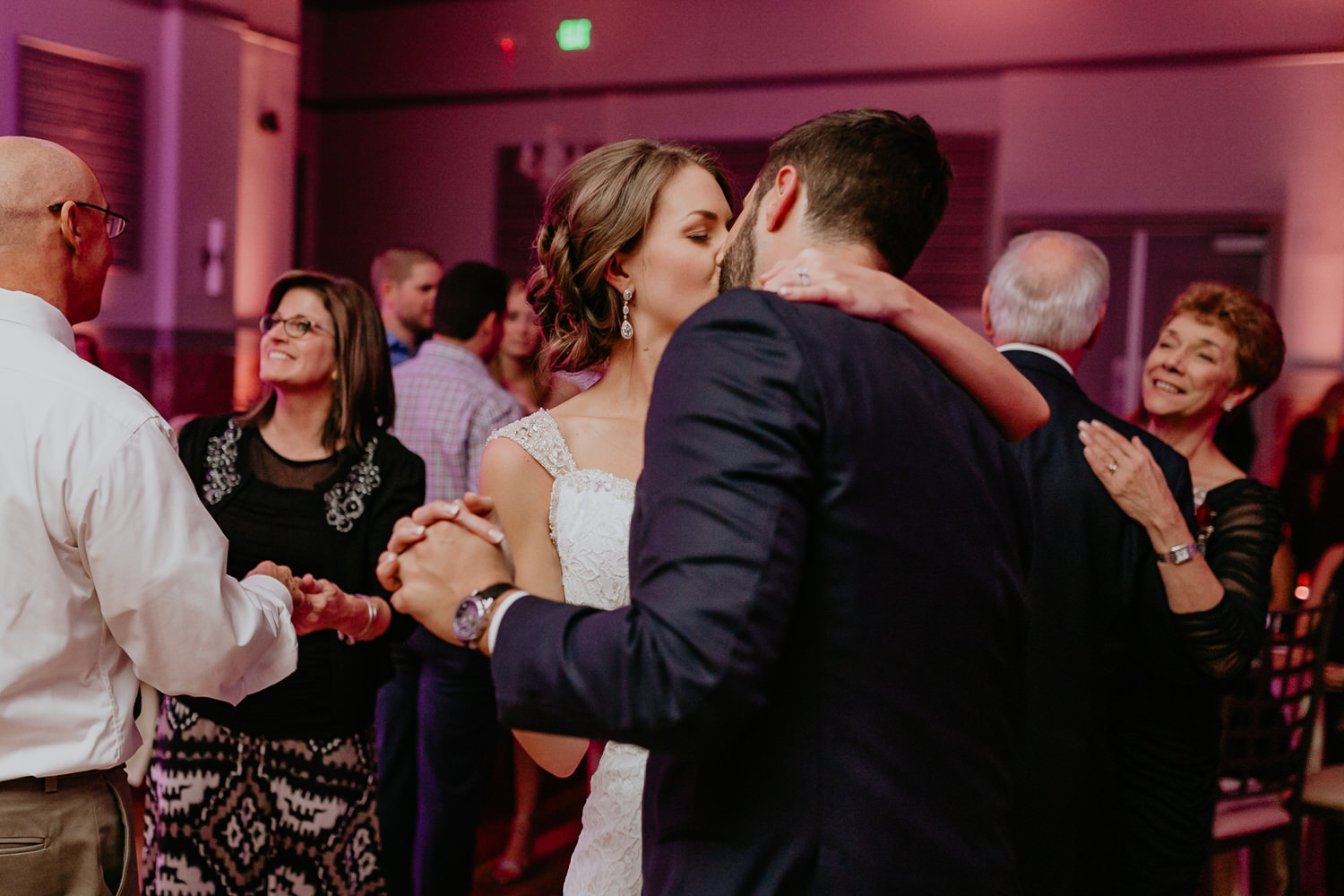 newlyweds kissing on the middle of the dance floor