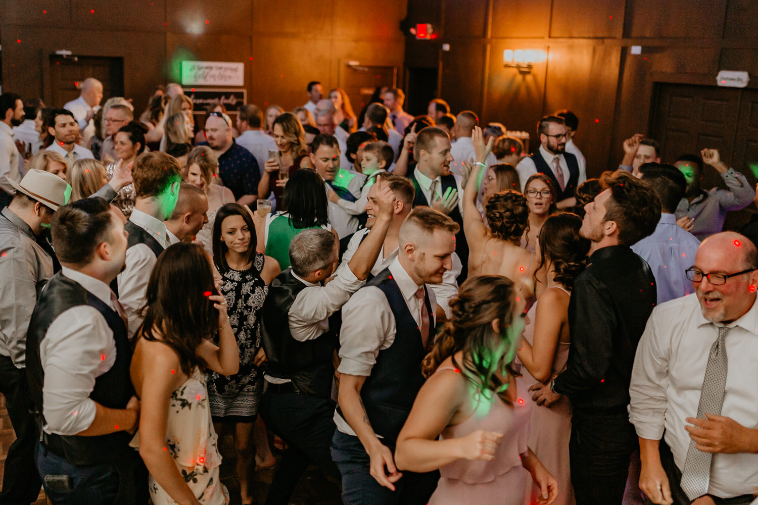 wide shot of all the wedding guests dancing at ever after farm