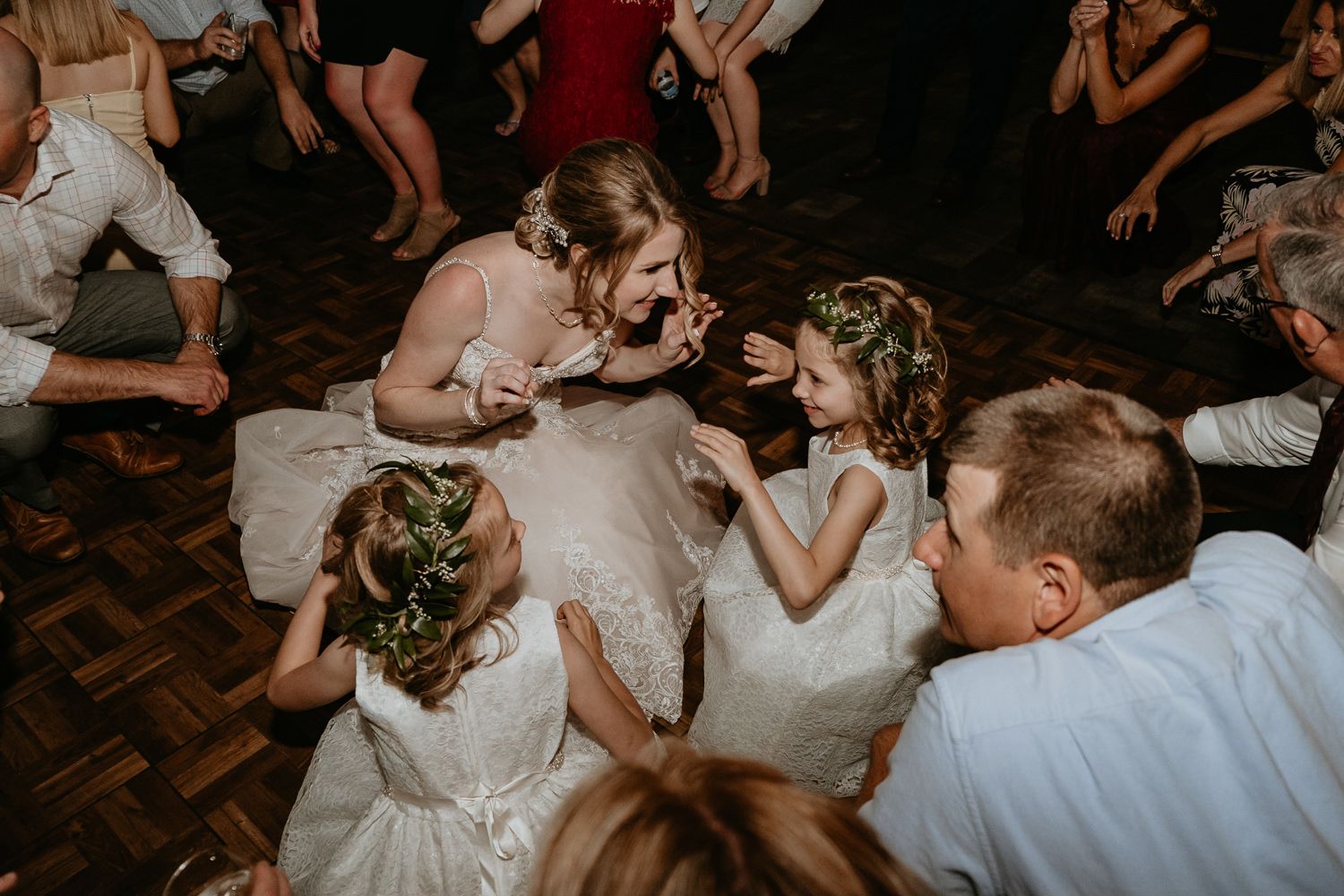 bride on the dance floor dipping and dancing with flower girls