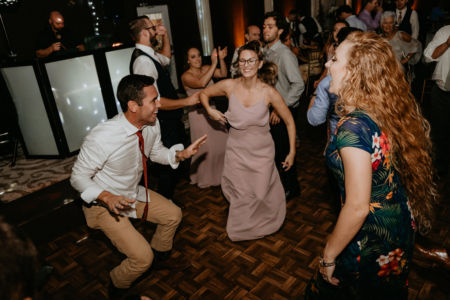 wedding guests dancing hair flapping in air