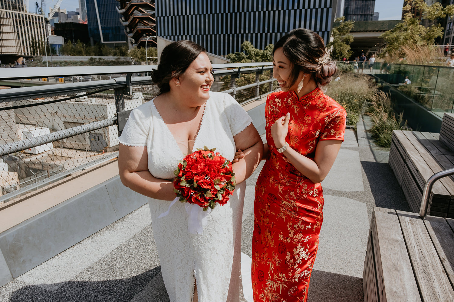 close up of two brides walking and laughing at each other