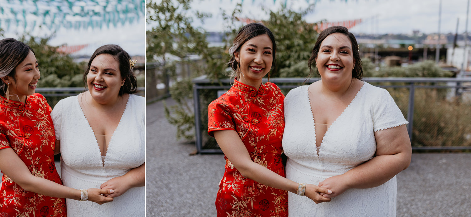 same sex brides next to each other holding hands smiling
