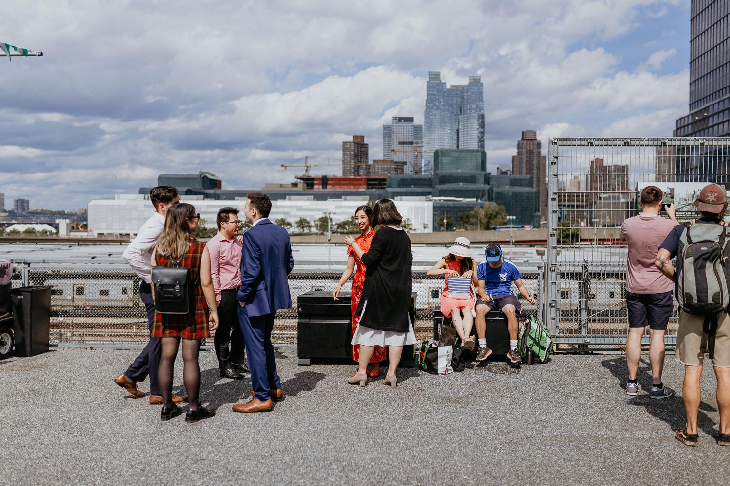 wide shot of bride with her friends at the high line with the views on NYC in the background