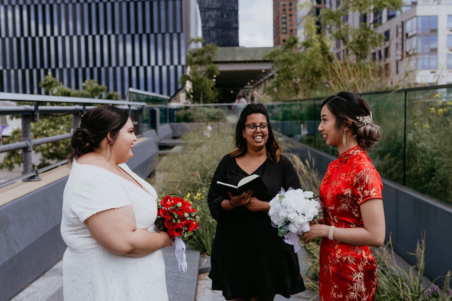 same sex wedding ceremony with two brides at the nyc high line park