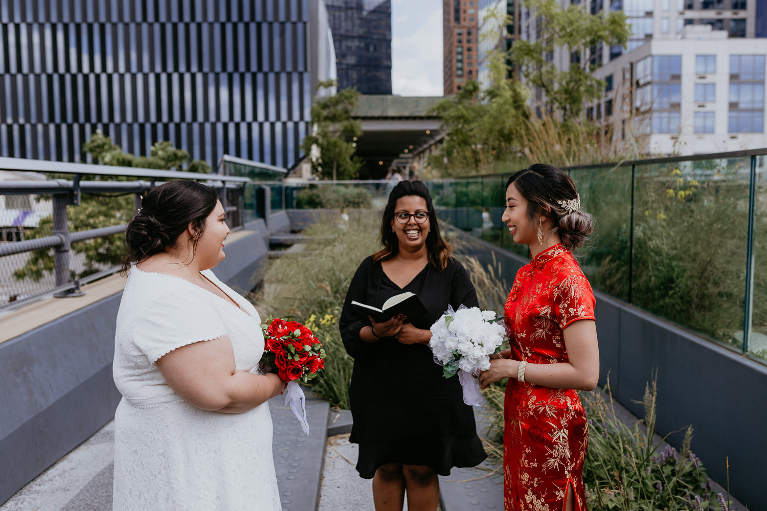 same sex wedding ceremony with two brides at the nyc high line park facing each other