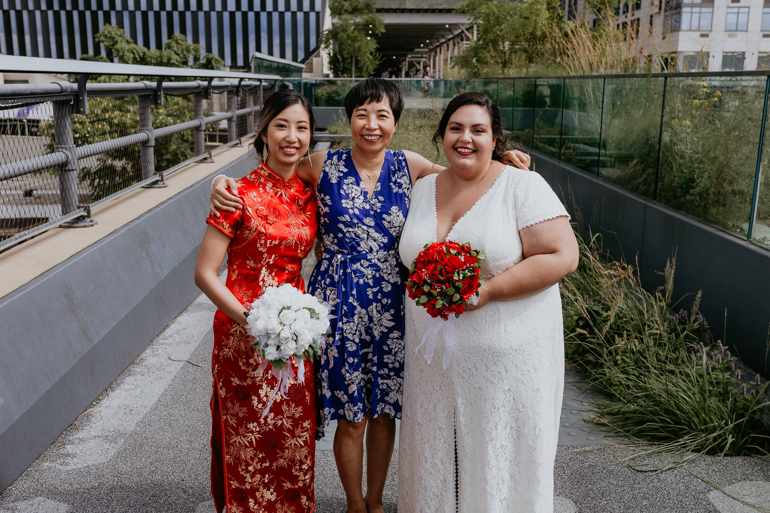 mom in the middle of two brides