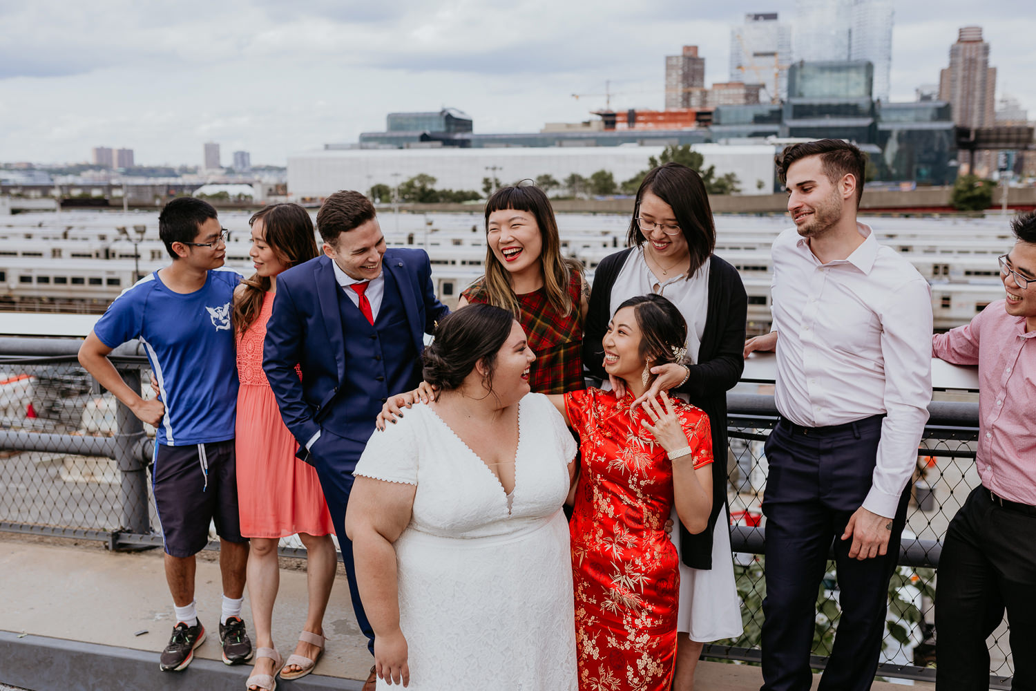 two brides and friends laughing with New York city views in background