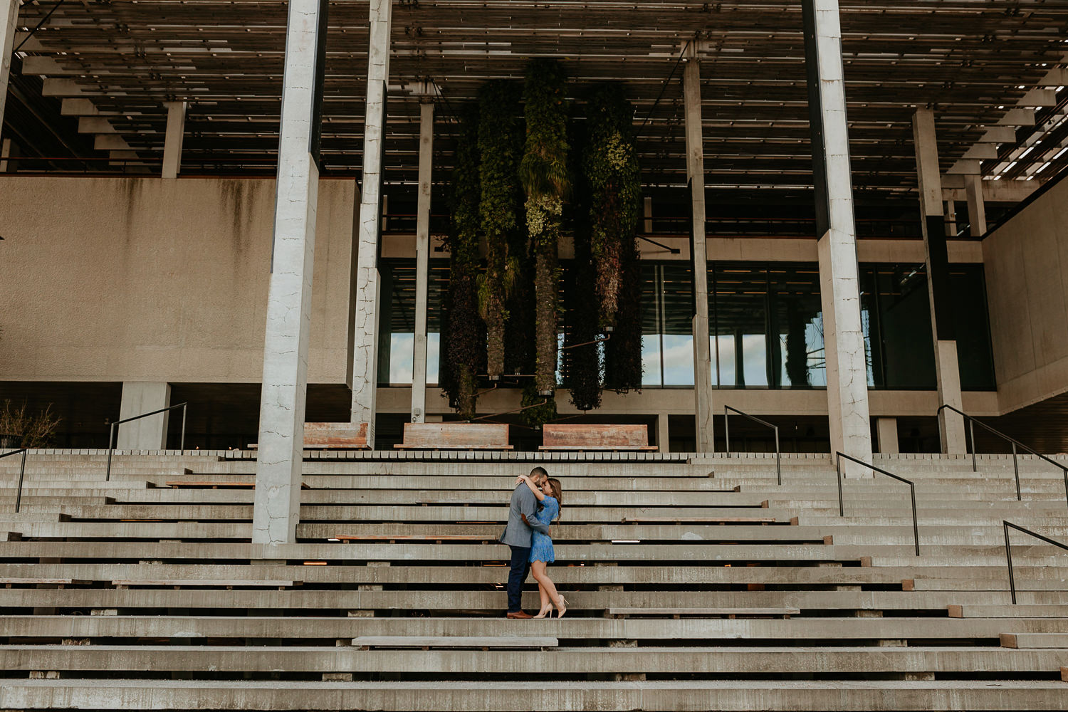 his got his arms around her waist, she has hers around his shoulders at pamm steps
