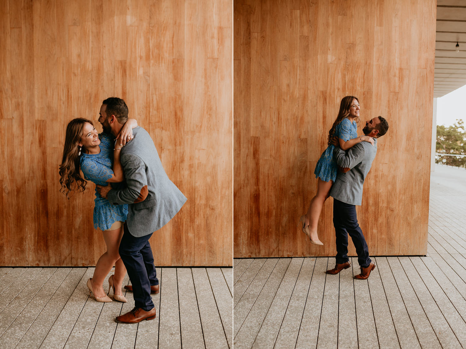 man picking up his new fiancé in front of big wooden wall