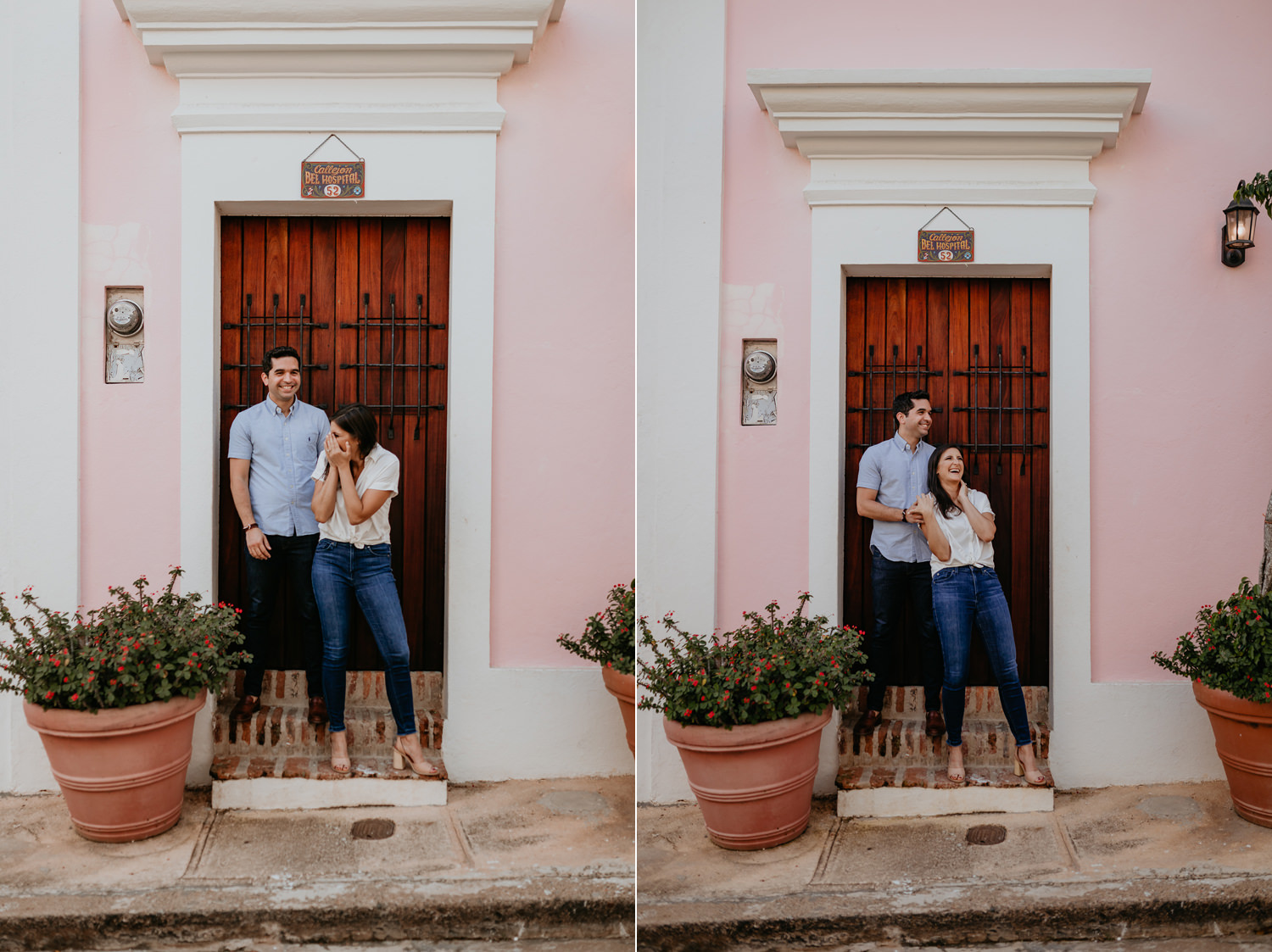 couple smiling and laughing standing in front of wooden door and pink house