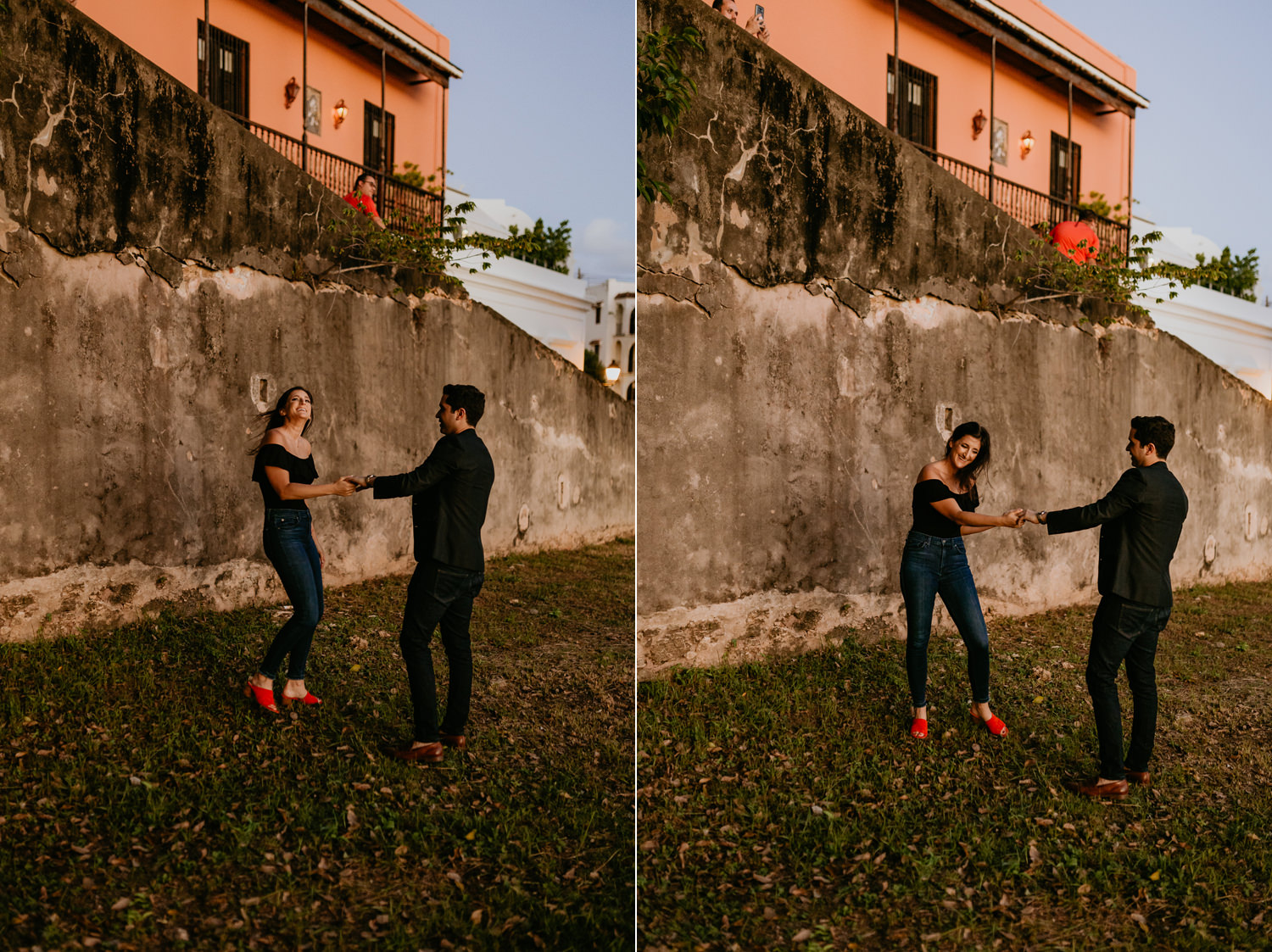 couple wearing dark clothes dancing in front of stone wall with sunset colors